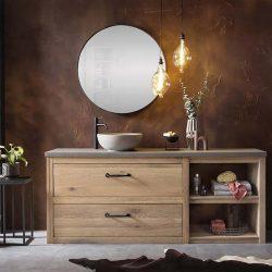 houten wastafelmeubel met een betonnen waskom en zwarte spiegel