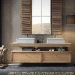 een eiken badkamermeubel met twee kranen en waskommen